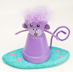 A Purple Surfing Monkey