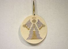 Pen-Pencil Cross Stitch Angel finished and hanging