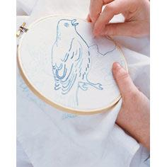 Bird-Embroidered Quilt