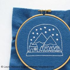 Embroider a festive snow globe